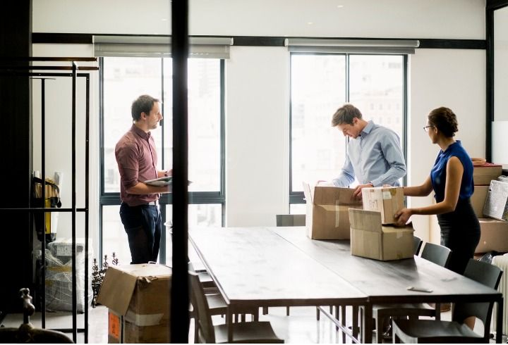 business-people-packing-boxes-at-table-in-office-picture-id642479676 (1)